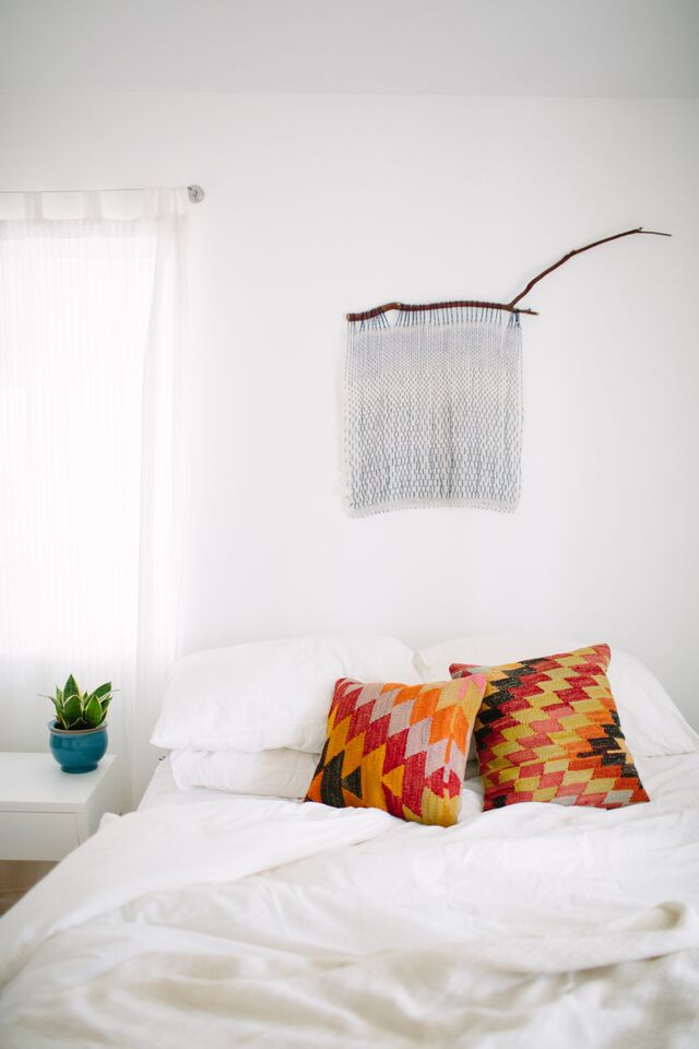 White Bedroom With Global Pillows